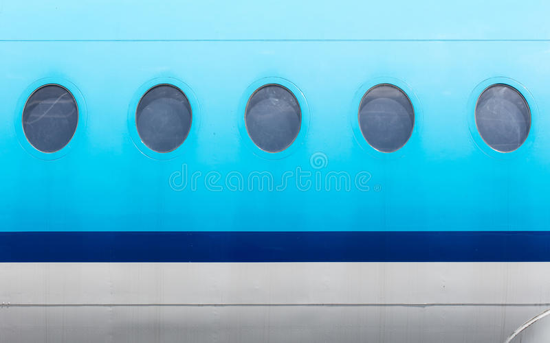 Windows голубого самолета стоковые фото