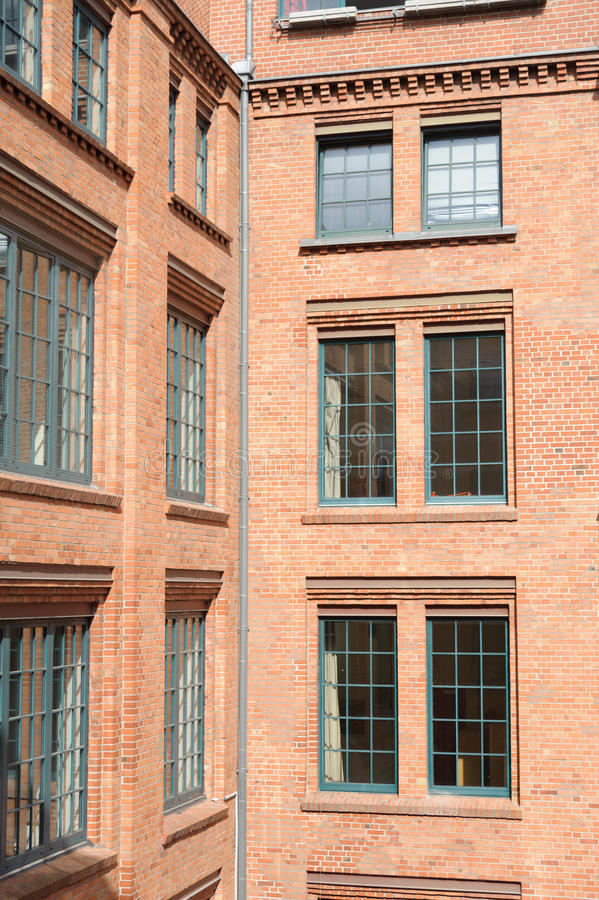 Windows. On the red brick wall stock image