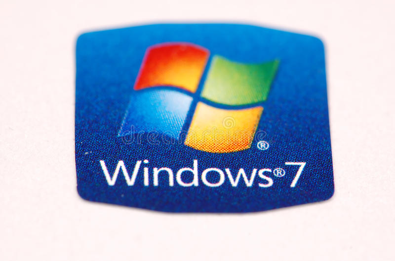Windows 7. Sticker on white notebook, widows operating system logo and text with windows 7. sticker is on white background