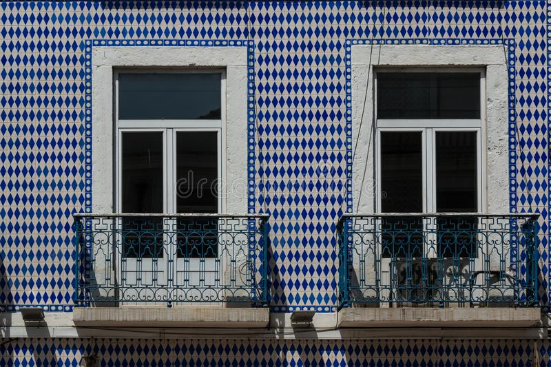 Windows with balconies and portuguese tiles royalty free stock photo
