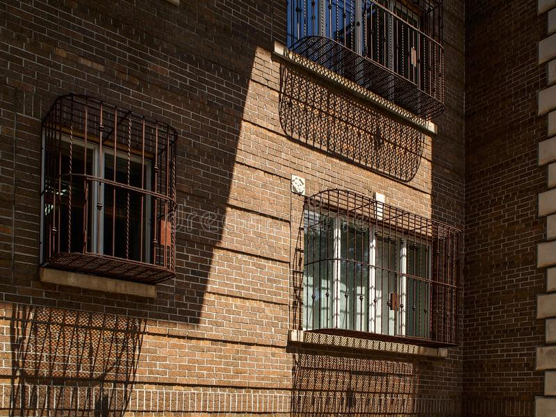 Windows with bars in a building of Williamsburg neighborhood. Windows with bars in a building in Williamsburg neighborhood in New York royalty free stock image