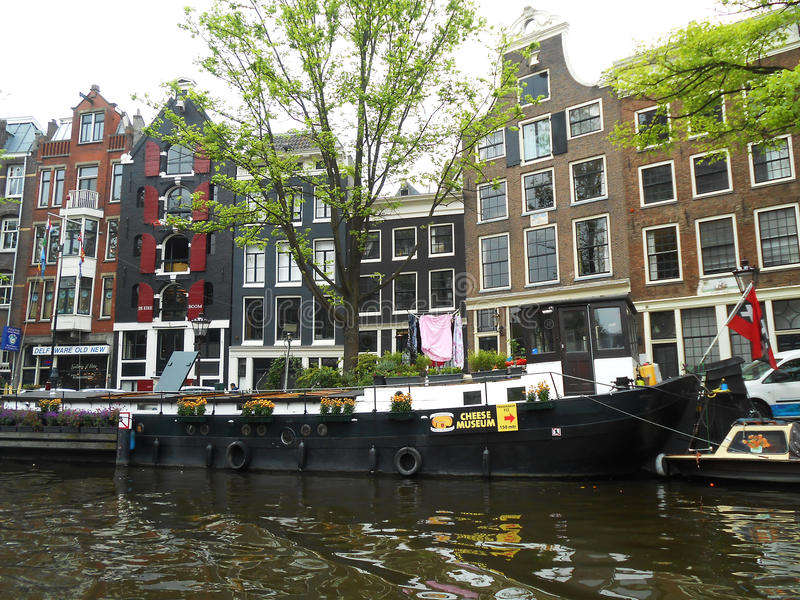WINDOWS AND BLACK BOAT, AMSTERDAM, HOLLAND royalty free stock photography