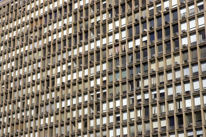 Windows in a building. Manhattan, New York, America, USA royalty free stock image