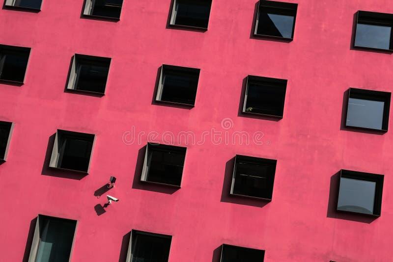 Windows on building exterior, security cameras stock image