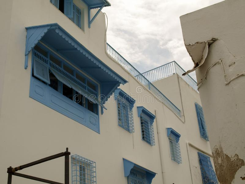 Windows and buildings close to the center of Sidi Bou Said, the famous village with traditional Tunisian architecture royalty free stock image