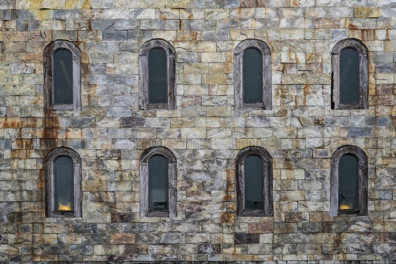 Windows on a castle`s wall. Old style glass windows on a castle`s wall royalty free stock image