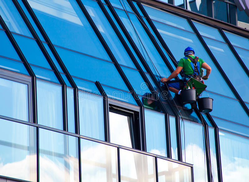 Windows cleaner at work royalty free stock images
