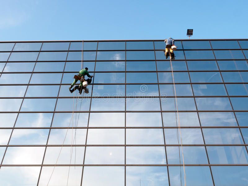 Windows cleaners. At the mall stock photography