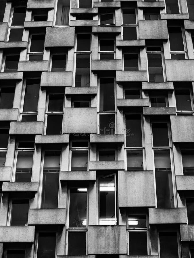 Windows in a concrete office building. Concrete face and windows in a 1960s office building royalty free stock image