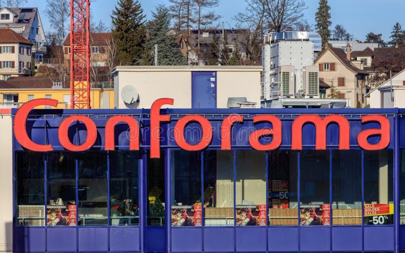 Windows of the Conforama store in Wallisellen, Switzerland. Wallisellen, Switzerland - 28 December, 2016: windows of the Conforama store, buildings of the town stock photo