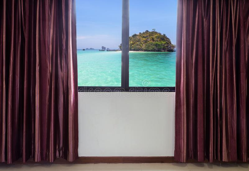 Windows with curtains and blinds looking out the window frame meet tropical seaside view stock photo