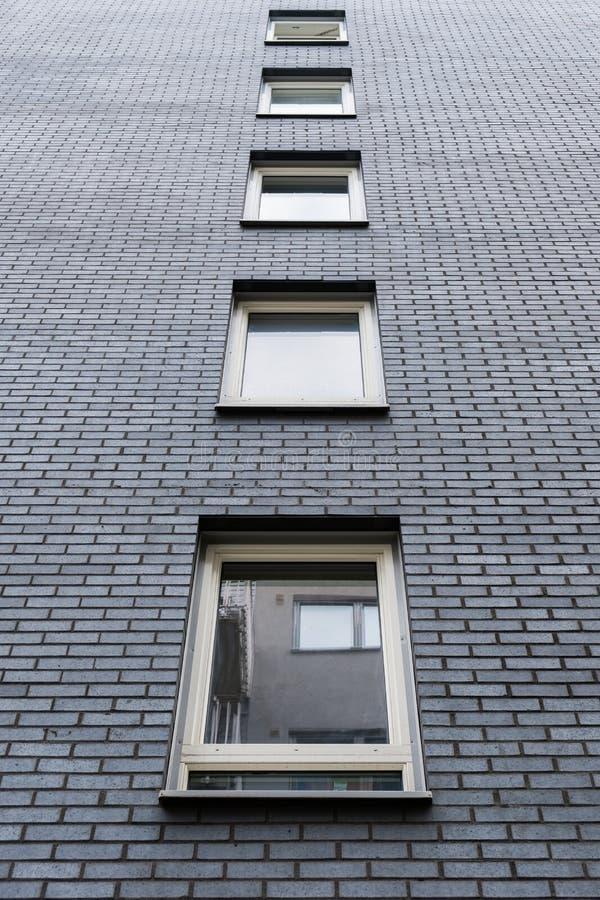 Windows on dark grey brick stock photo