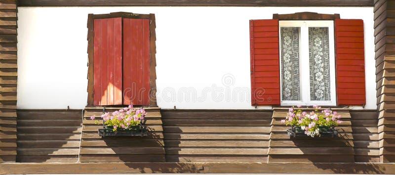 Windows with flowers, Misurina, Italy royalty free stock photo