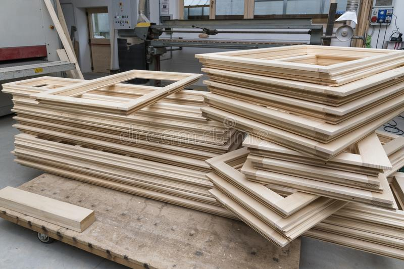 Windows frame production in joinery. Wooden windows frame production in joinery royalty free stock image