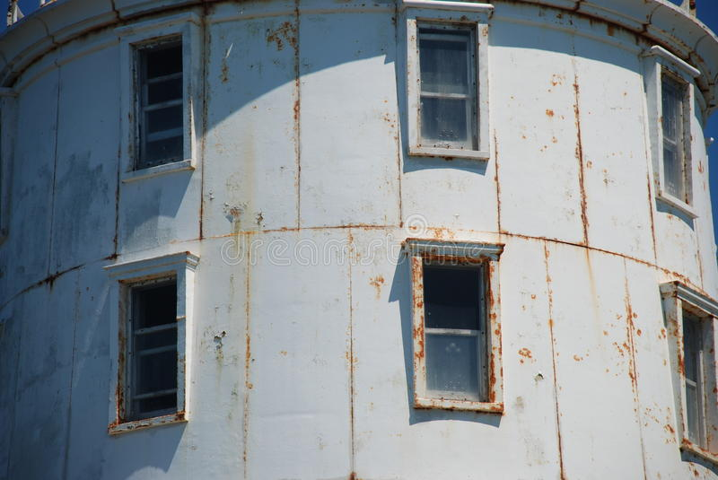 Windows on Harbor of Refuge Lighthouse, Lewes, Delaware. Closer View of the windows of Harbor of Refuge Lighthouse Located in Lewes Beach Delaware. Lighthouse is royalty free stock image