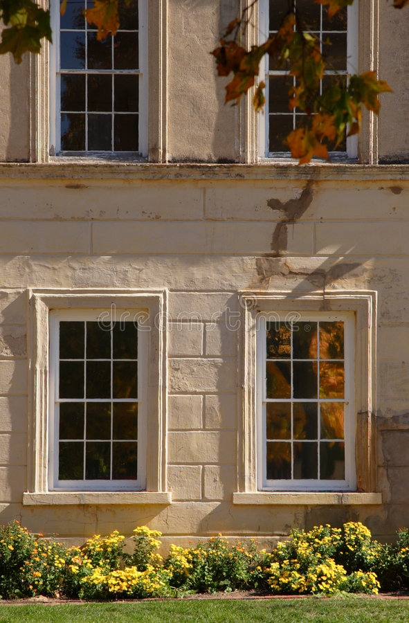 Windows in Historic Building. Windows with reflection in historic building in Bishop Hill, Illinois stock photography