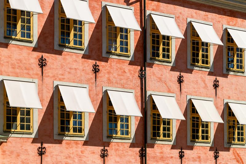 Windows on historical building of Stenbock Palaces, Stockholm, Sweden. Windows on facade of historical building of Stenbock Palaces, Stockholm, Sweden. Sunny stock images
