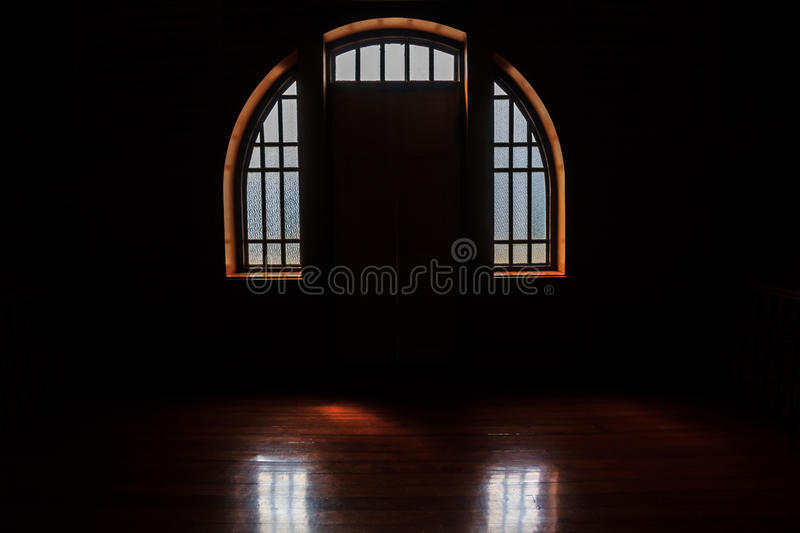 Windows light in the darkness room, dark windows background. royalty free stock images