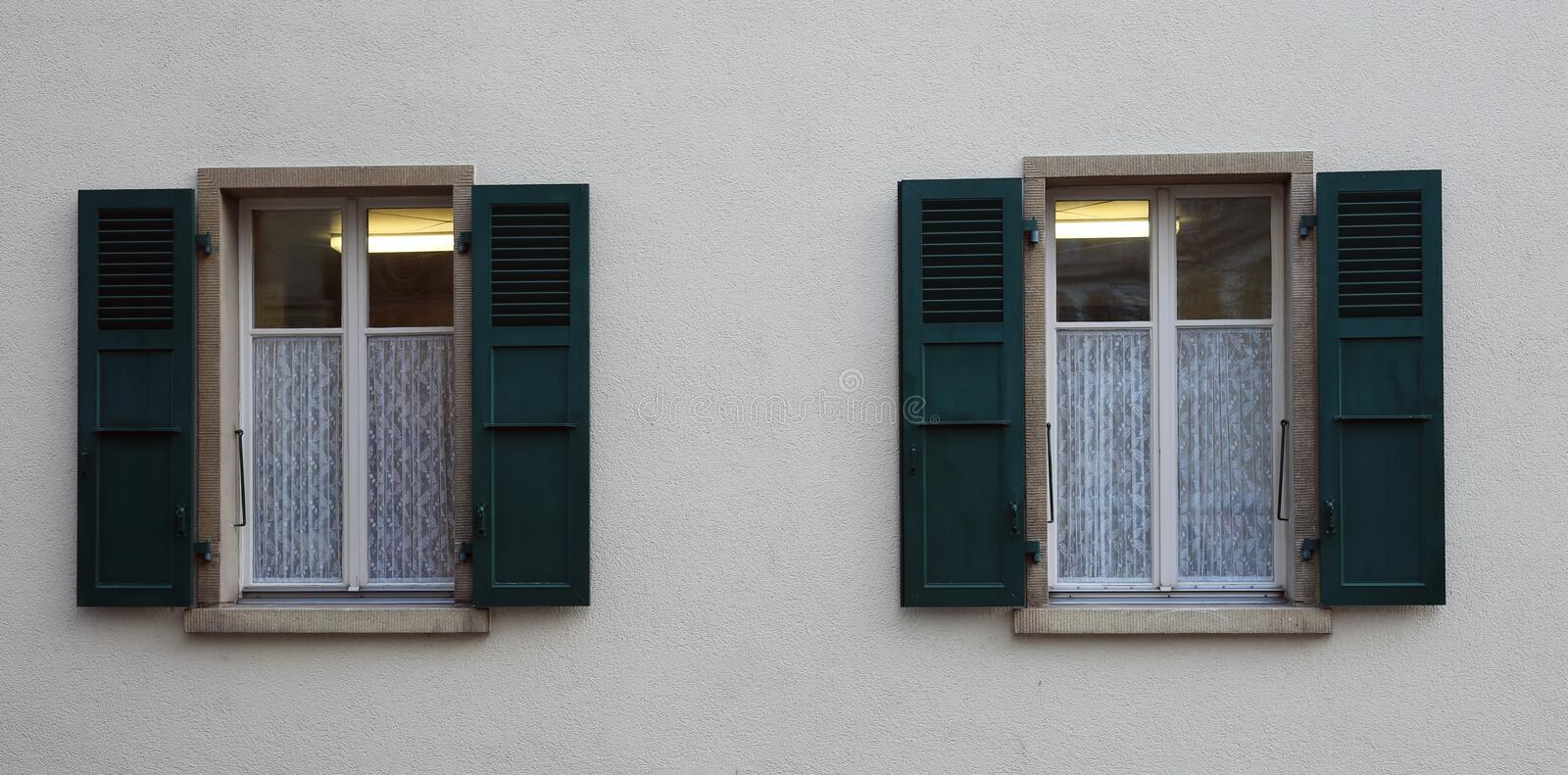 Windows of a Medieval Style Building in Switzerland. Beautiful medieval style windows of a building. This is photographed in Nyon, Switzerland. A small medieval royalty free stock images