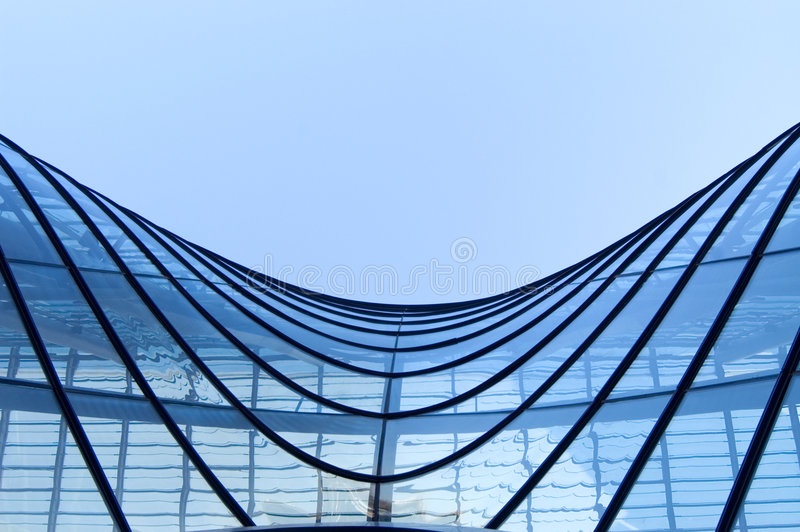 Windows by modern building. In blue sky royalty free stock photos