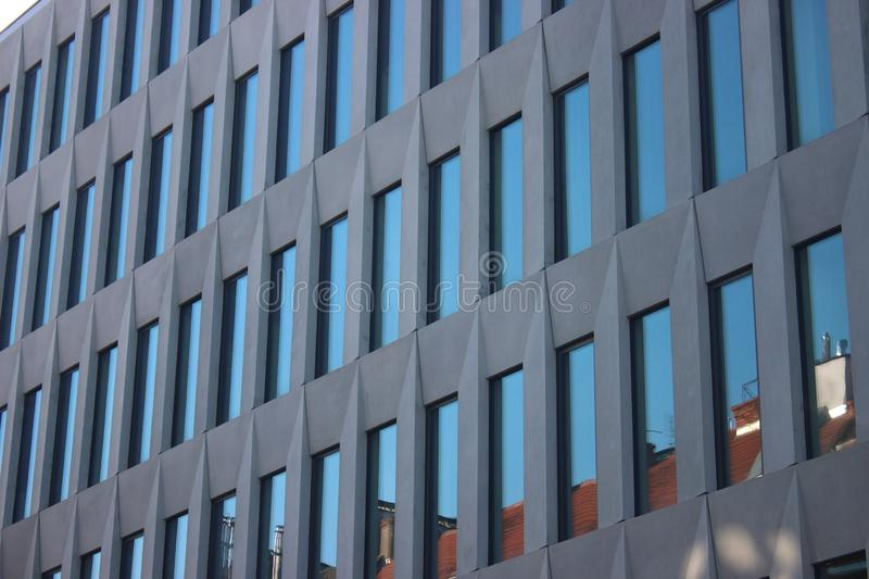 Windows of a modern house. glass skyscraper in the city, fashionable office building with floor-to-ceiling Windows. bright rooms. Windows of modern house. glass royalty free stock images