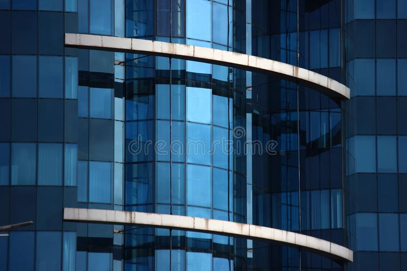 Windows of a modern house. glass skyscraper in the city, fashionable office building with floor-to-ceiling Windows. bright rooms. Windows of modern house. glass royalty free stock photo