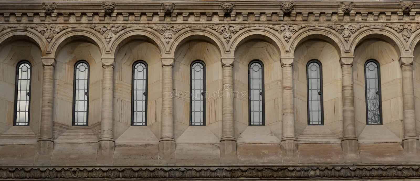 Windows in Neo-Gothic style. Windows in Victorian Gothic, Neo-Gothic or Jigsaw Gothic style royalty free stock images