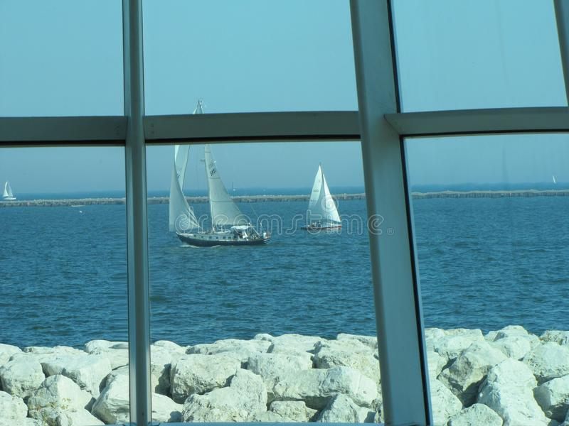 Windows offer a unique view of Lake Michigan stock photography