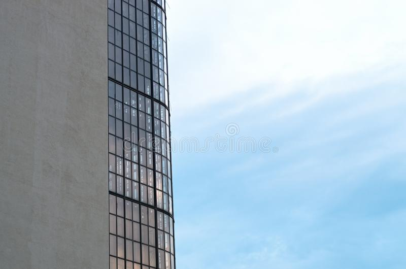 Windows of an office building against the sky. Industrial background stock images