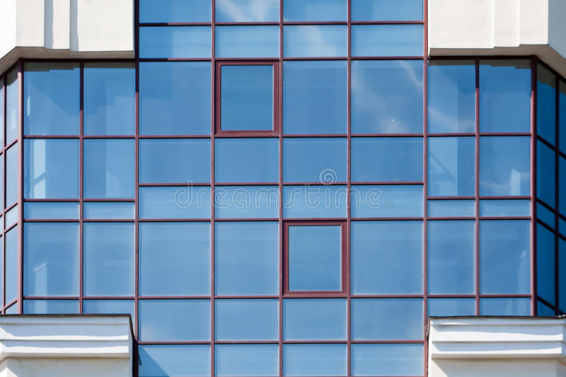 Windows of office building. Clouds reflected in windows of modern office building stock photography