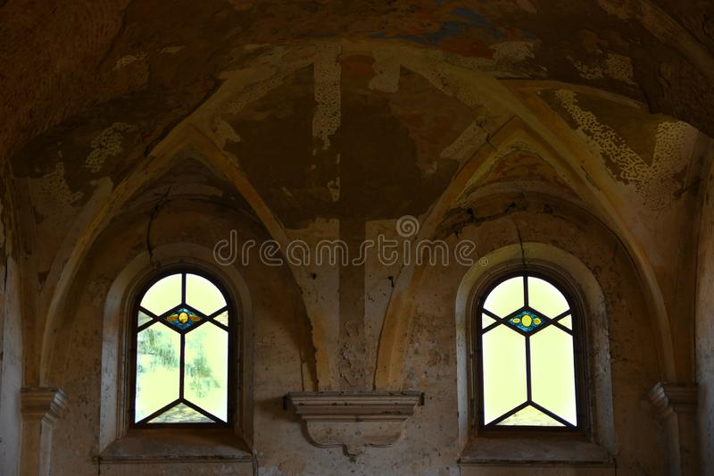 Windows of an old church. Two windows of an old church with painting and stained glass stock photography