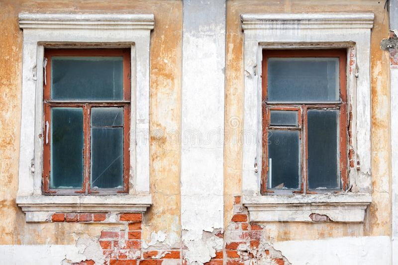 Windows in an old house with damaged walls. Windows in an old house with damaged brick walls royalty free stock image