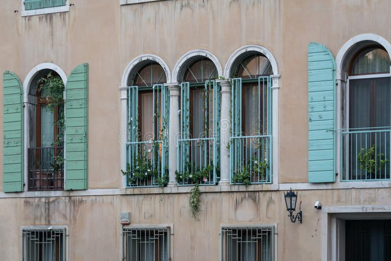 Windows of an old house in Venice, Italy stock photography
