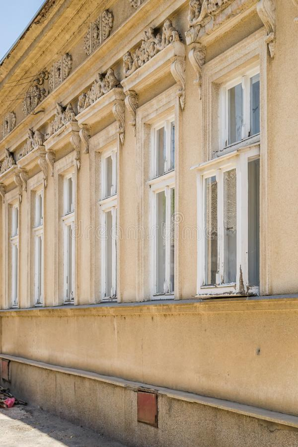 The windows of the old houses in Sremski Karlovci, Serbia. Sremski Karlovci, Serbia - June 12, 2019: The windows of the old houses in Sremski Karlovci, Serbia stock images