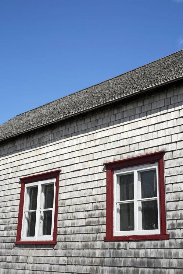 Windows of an old rustic house royalty free stock photo