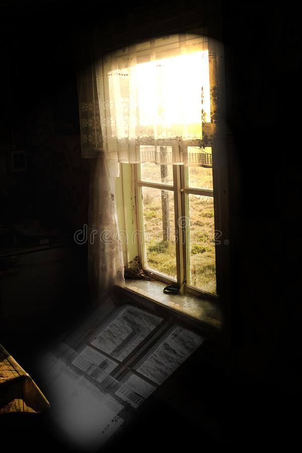 The windows of the old wooden house. the reflection of the window on the floor in black. the past does not return as childhood. royalty free stock image