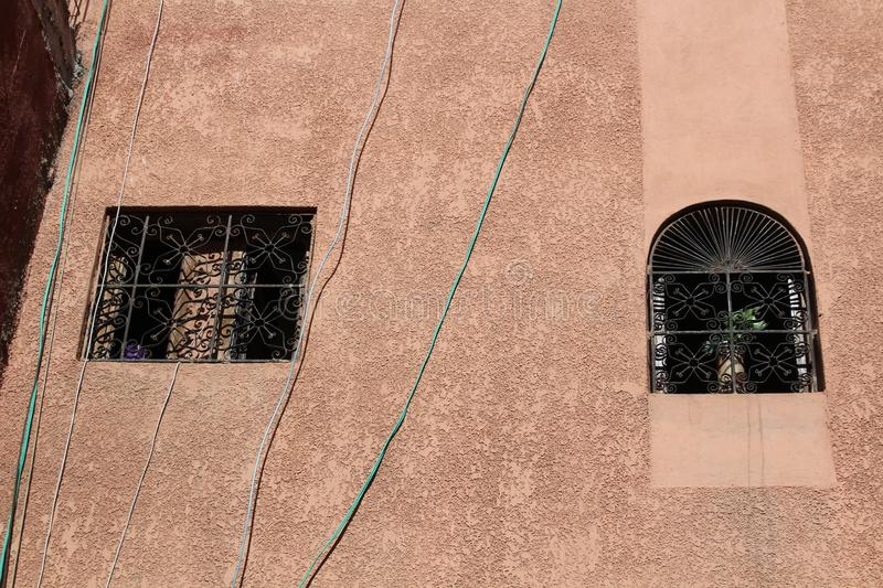 Windows with ornamental grates in medina - historical centre of Marrakesh royalty free stock photo