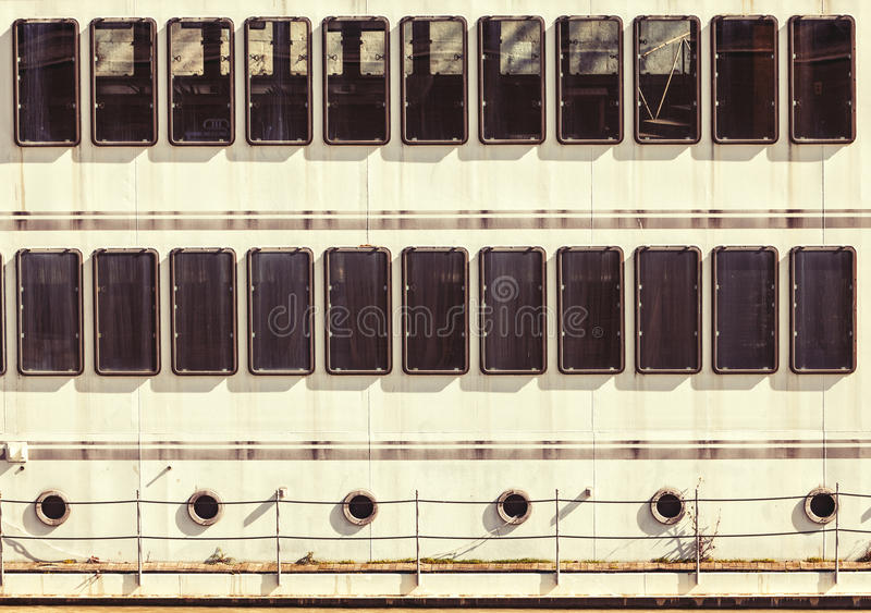 Windows portholes facade of a ship. Regular background stock images