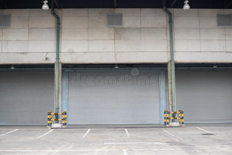 Windows protected with roller shutters, background texture royalty free stock photo