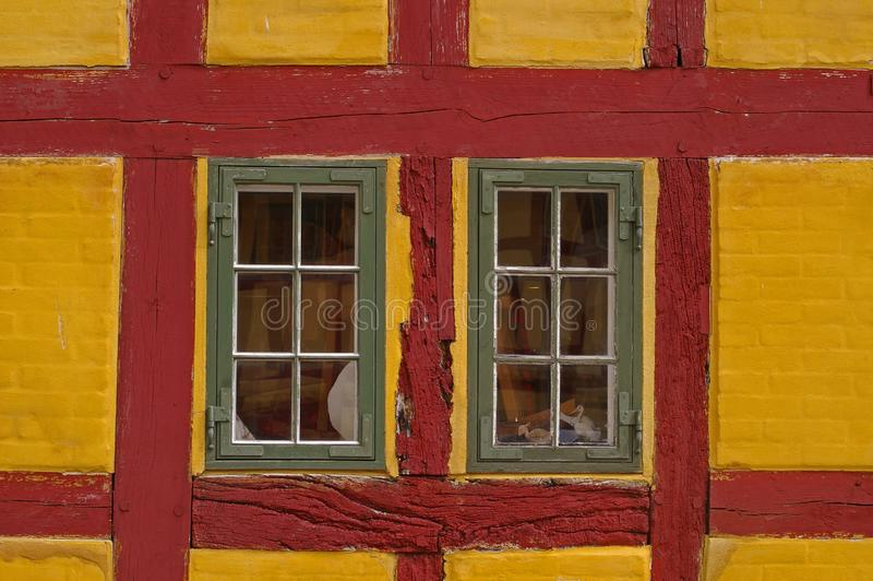 Windows in red and yellow building stock photography