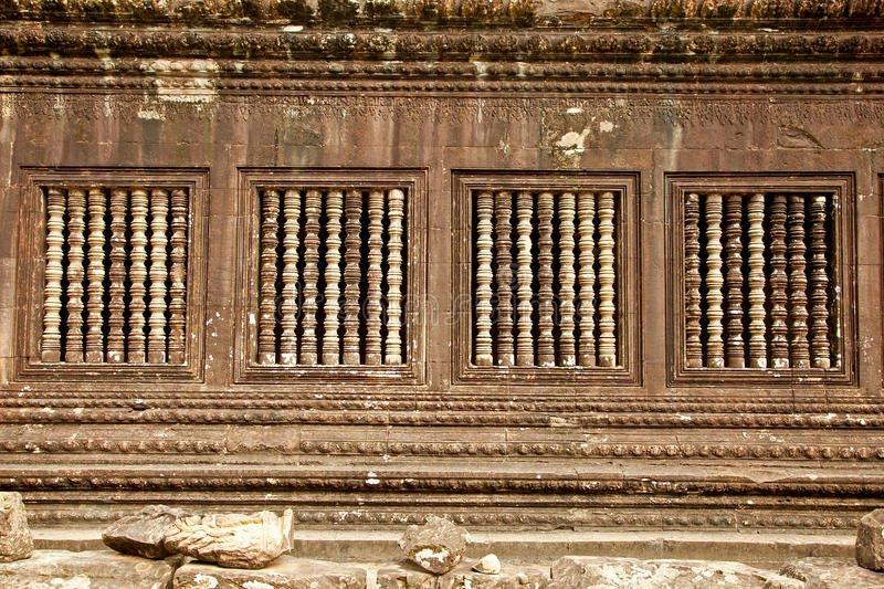 Windows relief of famous Angkor Wat, Cambodia. Windows relief of famous Angkor Wat temple complex, near Siem Reap, Cambodia royalty free stock images