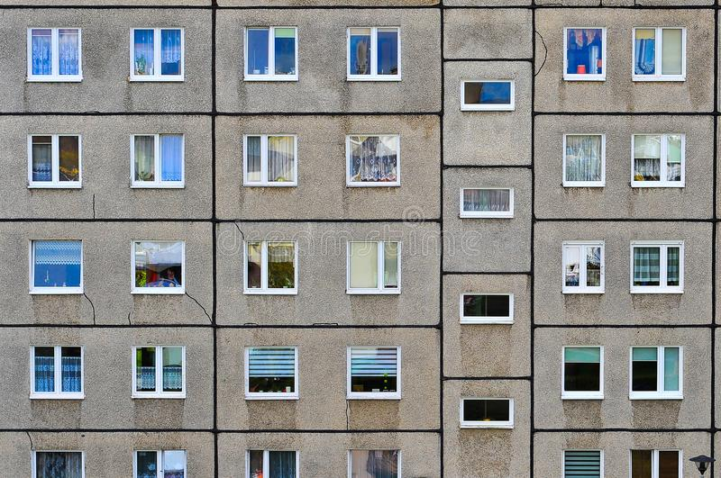 Windows in a residential block. An image of a old post communist residential apartments complex royalty free stock photography