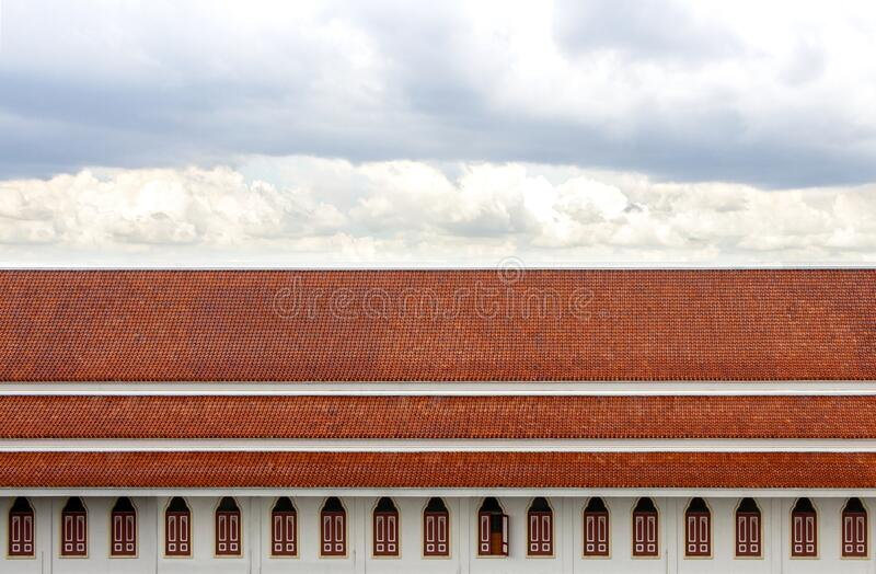 Windows and roof made of tile wiht beautiful sky background royalty free stock photos