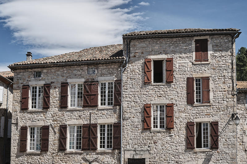 Windows with shutters in stone houses stock photo