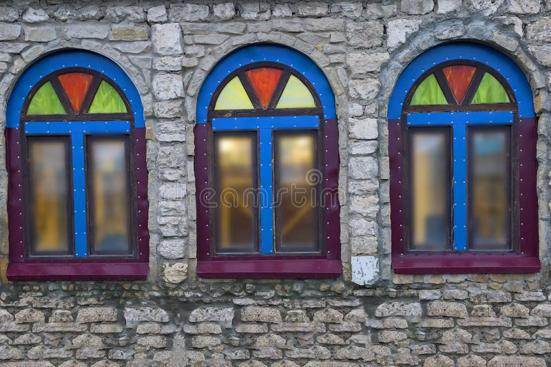 Windows in a stone building with coloured glass royalty free stock photos