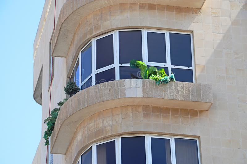 Windows in a stylish building. Windows with a box planter in a stylish building royalty free stock photography