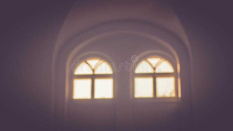 Windows of a temple with sun lights. Windows of a temple and sun lights royalty free stock images