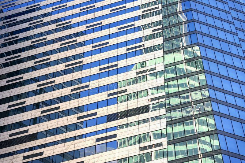 Windows of under construction high-rise building, view of modern glass and concrete exterior of high rise building stock image