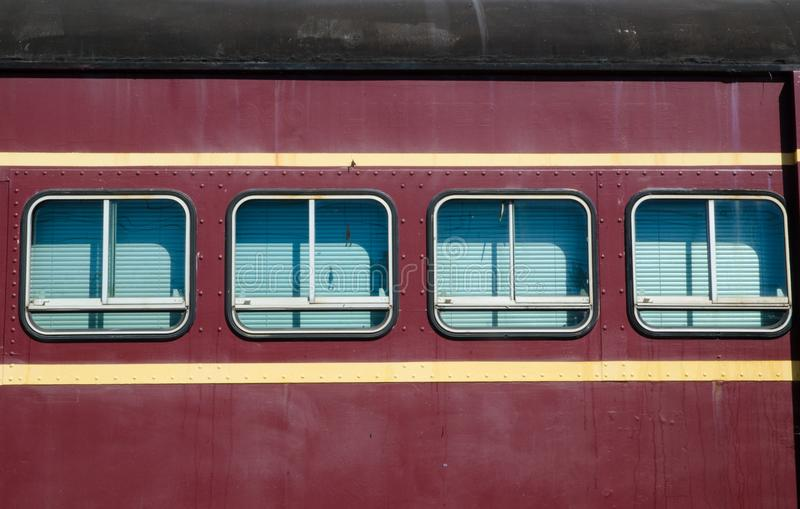 Windows of the Vintage train in Maroon color. A square Windows of the Vintage train in Maroon color royalty free stock photo