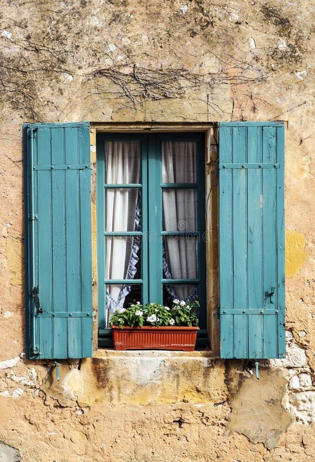 Windows on wall stone stock photo
